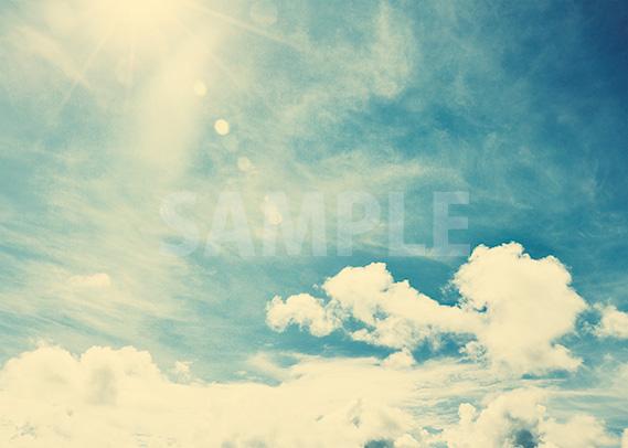 セピアがかった青い空のA4サイズ背景素材