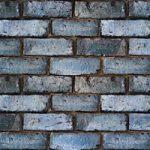 ゴツゴツした青色のレンガのA4サイズ背景素材