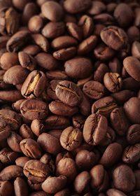 コーヒ豆が一面に散らばるA4サイズ背景素材