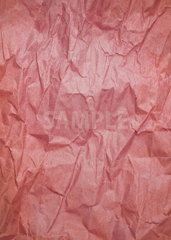 赤いくしゃくしゃな紙のA4サイズ背景素材