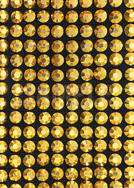 金色に輝くスパンコールが並ぶA4サイズ背景素材
