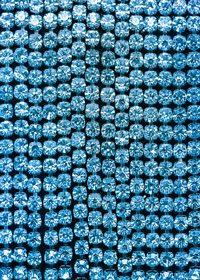 青色のスパンコールがキラリと光るA4サイズ背景素材
