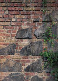 大きい岩が入ったレンガのA4サイズ背景素材