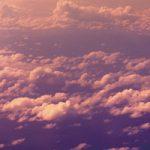 紫色フィルター越しの雲を見下ろしたA4サイズ背景素材