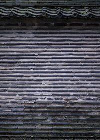 瓦と石の和装外壁のA4サイズ背景素材データ