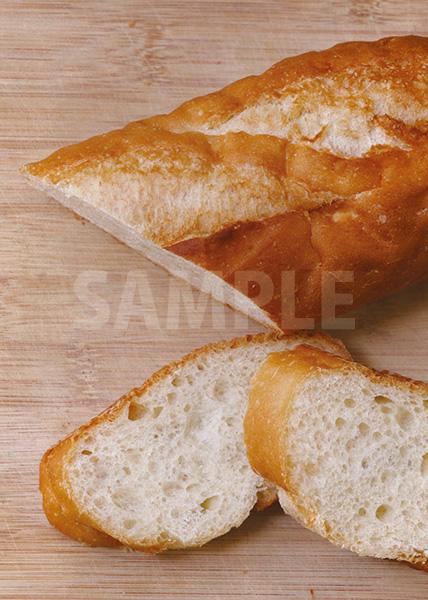 カットされたフランスパンのA4サイズ背景素材