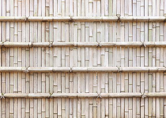 薄っすらオレンジ色の竹垣のA4サイズ背景素材