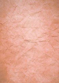 赤色のくしゃくしゃな紙のA4サイズ背景素材