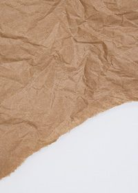 斜めに破れた紙のA4サイズ背景素材